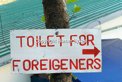 Toilets for Foreigeners sign Asia. Foreigners, tourists toilet WC lavatory