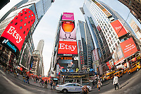 Giant electronic billboards in Times Square and on the NASDAQ commemorate the Etsy initial public offering which debuted to the public on Thursday, April 16, 2015. Founded a decade ago the crafty web portal raised $267 million in its IPO. (© Richard B. Levine)