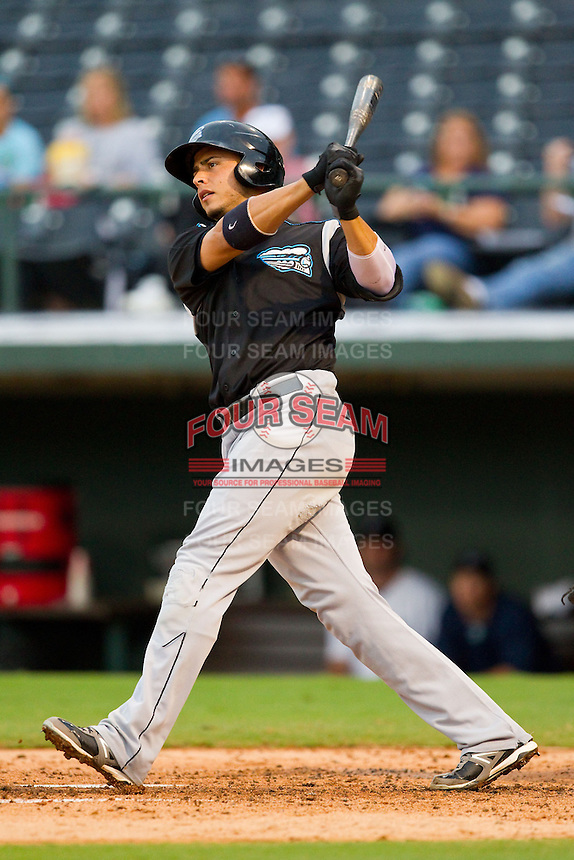 Carlos Rivero (21) of the Syracuse Chiefs follows through on his swing against the Charlotte Knights at Knights Stadium on August 29, 2012 in Fort Mill, South Carolina.  (Brian Westerholt/Four Seam Images)