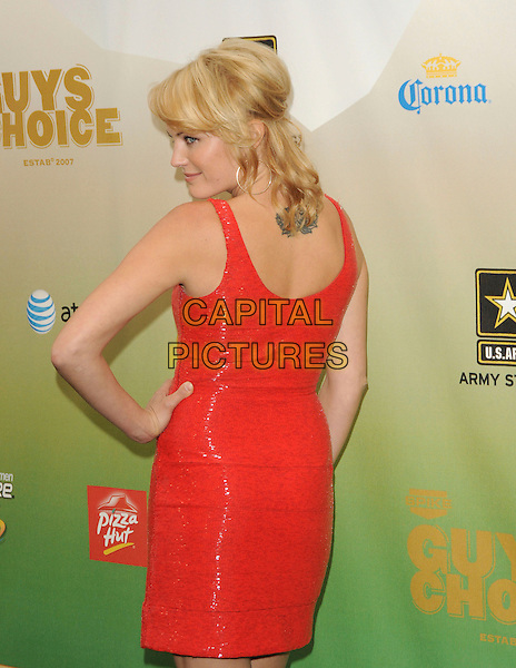 MALIN AKERMAN .at The 2009 Spike TV Guy's Choice Awards held at Sony Picture Studios in Culver City, California, May 30th 2009.                                                                     .half length red dress  shiny shimmery back rear behind tattoo hand on hip.CAP/DVS.©Debbie VanStory/RockinExposures/Capital Pictures