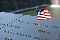 A small American flag left on the names at the National 9/11 Memorial in New York City.