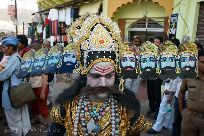 actor performing as Rahwana, major evil character in Ramayana epos, street procession  in Pushkar, Rajastan, India