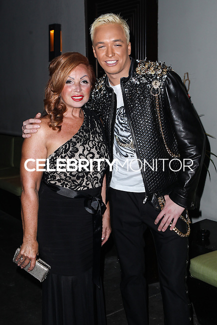 STUDIO CITY, CA - JUNE 23: Tina Trozzo and KUBA Ka attend Polish Popstar KUBA Ka's concert at La Maison in Studio City on June 23, 2013 in Studio City, California. (Photo by Celebrity Monitor)