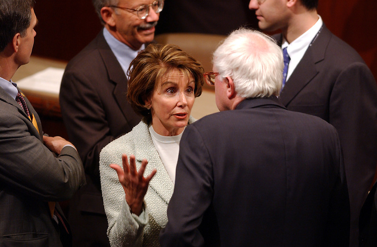 House14_010703 -- Nancy Pelosi, D-CA., talks with Bernard Sanders, I-VT., during the opening session of the 108th Congress.