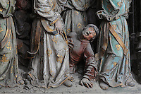 Sick man hoping to be healed, from the scene of carrying the relics of St Firmin to Amiens, Gothic style polychrome high-relief sculpture from the South side of the choir screen, 1490-1530, commissioned by canon Adrien de Henencourt, depicting the life of St Firmin, at the Basilique Cathedrale Notre-Dame d'Amiens or Cathedral Basilica of Our Lady of Amiens, built 1220-70 in Gothic style, Amiens, Picardy, France. St Firmin, 272-303 AD, was the first bishop of Amiens. Amiens Cathedral was listed as a UNESCO World Heritage Site in 1981. Picture by Manuel Cohen