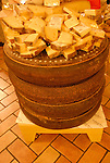 DiBruno Brothers cheese and gourmet food shop.  Cut cheese and large wheels of cheese. .Philadelphia, Pennsylvania, PA USA.  Photo copyright Lee Foster, 510-549-2202, lee@fostertravel.com, www.fostertravel.com. Photo 319-30879