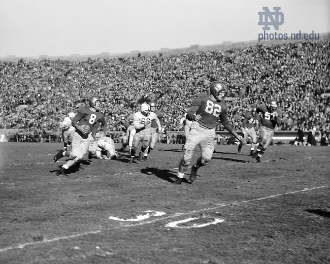 GMCJ 1/20:  Football Game Scene - Notre Dame vs. Washington, 1948/1127.  Player Frank Tripucka (#8) running with the ball as Leon Hart (#82) blocks..Image from the University of Notre Dame Archives.