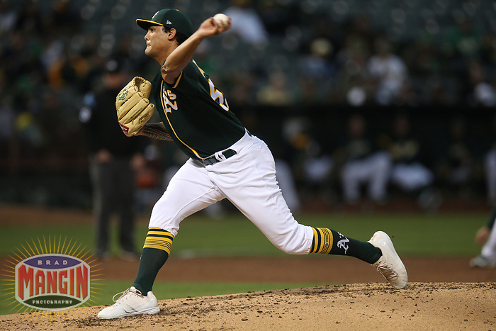 OAKLAND, CA - AUGUST 13:  Sean Manaea #55 of the Oakland Athletics pitches against the Seattle Mariners during the game at the Oakland Coliseum on Monday, August 13, 2018 in Oakland, California. (Photo by Brad Mangin)