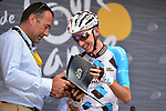 Yesterday's stage winner Romain Bardet (FRA) AG2R La Mondiale recieves his plaque from Thierry Gouvenau ASO at sign on before the start of Stage 13 of the 104th edition of the Tour de France 2017, running 101km from Saint-Girons to Foix, France. 14th July 2017.<br /> Picture: ASO/Pauline Ballet | Cyclefile<br /> <br /> <br /> All photos usage must carry mandatory copyright credit (&copy; Cyclefile | ASO/Pauline Ballet)