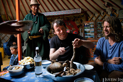 Sunday Times writer Tim Rayment enjoys Mongolian sheep innards as he reports on autistic child Rowan, 5, who is riding a horse in Mongolia, accompanied by his parents Rupert and Kristin, their Mongolian guide Tulga, his six-year-old son Bodibilguunson and an American documentary TV crew. .Rowan's parents believe horses and shamans can unlock their sonís autistic mind. This is their journey of discovery across Mongolia on horseback. .The story is published by the Sunday Times and accompany text by Tim Rayment.