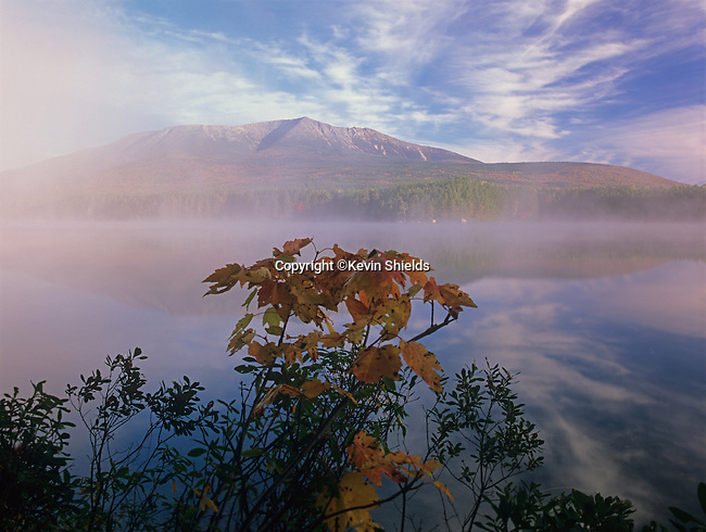 View of Mt. Katahdin with Fall colors and fog at Upper Togue Pond, Baxter State Park, Maine, USA