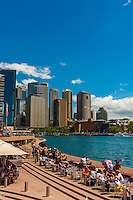 People enjoying the view of Sydney harbor from the Opera Bar, Sydney, New South Wales, Australia