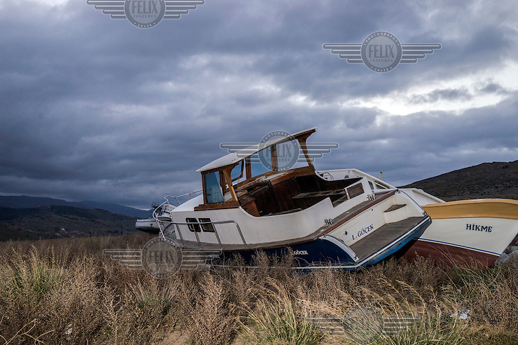 A salvaged boat that would have carried refugees from Turkey abandoned on a hilltop.