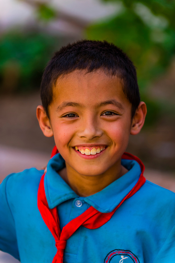 A happy Uyghur schoolboy in Turpan, Xinjiang Province, China. Turpan is a small oasis town and former Silk Road outpost located in a depression 30m above sea level. Uyghur people are a Central Asian people of Muslim Turkic origin. They are China's largest minority group.