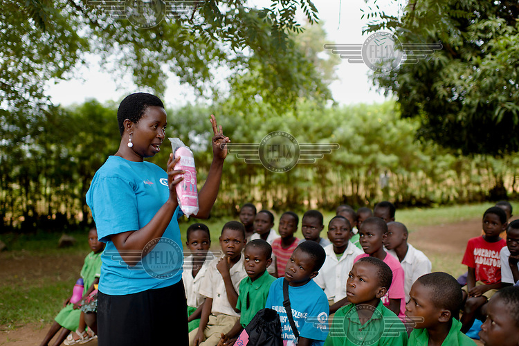 Lovisa Wankya, a teacher and an Afripads disributor, speaking to students at Achilet Primary School about menstrual hygiene and the correct use of Afripads. Afripads are, Ugandan made, reusable fibre sanitary pads that are having a revolutionary impact on menstrual hygiene management, particularly amongst girls and women who cannot afford expensive disposable pads, and who previously had to use rags, cotton wool or toilet paper.