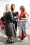 Camila Alves conversing at the Annie For Target collection celebration and pop-up shop at Stage 37 in New York City on November 4, 2014.