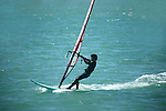 Windsurfing is a surface water sport that combines elements of surfing and sailing.<br /> (1)