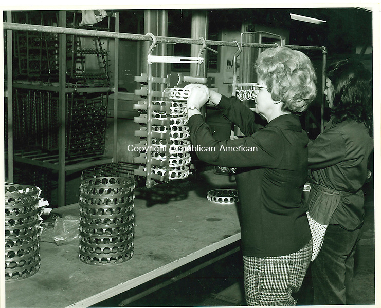 Silver plated aircraft bearings being unracked prior to inspection at Harper-Leader in Waterbury, 1974.