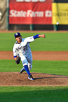 Victor Gonzalez (22) of the Ogden Raptors delivers a pitch to the plate against the Great Falls Voyagers in Pioneer League action at Lindquist Field on July 18, 2014 in Ogden, Utah.  (Stephen Smith/Four Seam Images)