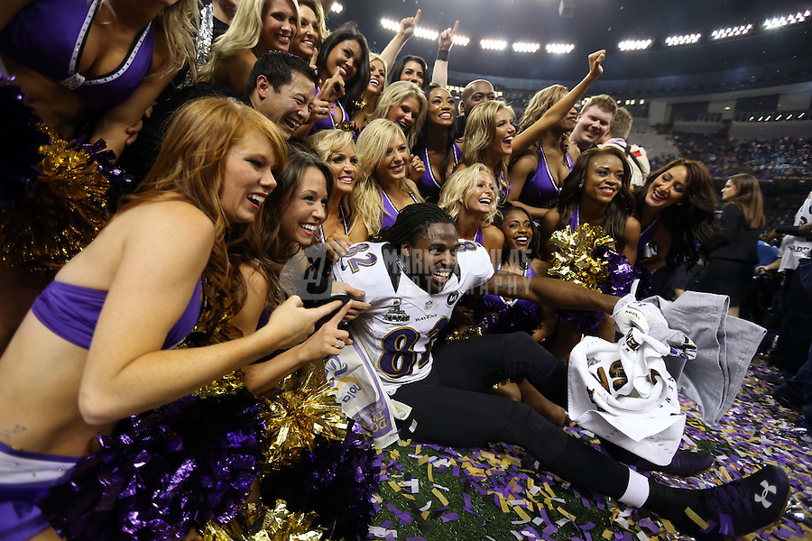 Feb 3, 2013; New Orleans, LA, USA; Baltimore Ravens wide receiver Torrey Smith (82) poses with the cheerleaders after defeating the San Francisco 49ers in Super Bowl XLVII at the Mercedes-Benz Superdome. Mandatory Credit: Mark J. Rebilas-