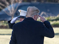 United States President Donald J. Trump salutes the Marine Guard as he boards Marine 1 to depart the White House in Washington, DC for a weekend of meetings at Camp David on Friday, January 5, 2018.<br /> CAP/MPI/RS<br /> &copy;RS/MPI/Capital Pictures