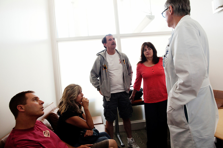 Los Angeles, California, May 15, 2012 - Alfredo Trento, MD, Director, Cardiothoracic Surgery Division at Cedars-Sinai Heart Institute speaks with the family of patient Betty Jean Trusel, whom Dr. Trento just performed a a Mitral Valve Repair on. ..