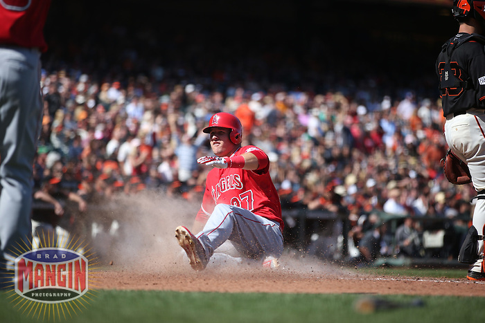 SAN FRANCISCO, CA - MAY 2:  Mike Trout #27 of the Los Angeles Angels slides home safely against the San Francisco Giants during the game at AT&T Park on Saturday, May 2, 2015 in San Francisco, California. Photo by Brad Mangin