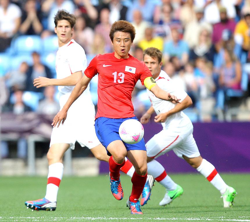 Korea Republic's KOO Jacheol in action during todays match  ..2012 London Olympics - Football - Group B -Korea Republic v Switzerland - Sunday 29th July 2012 - City of Coventry Stadium - Coventry ..