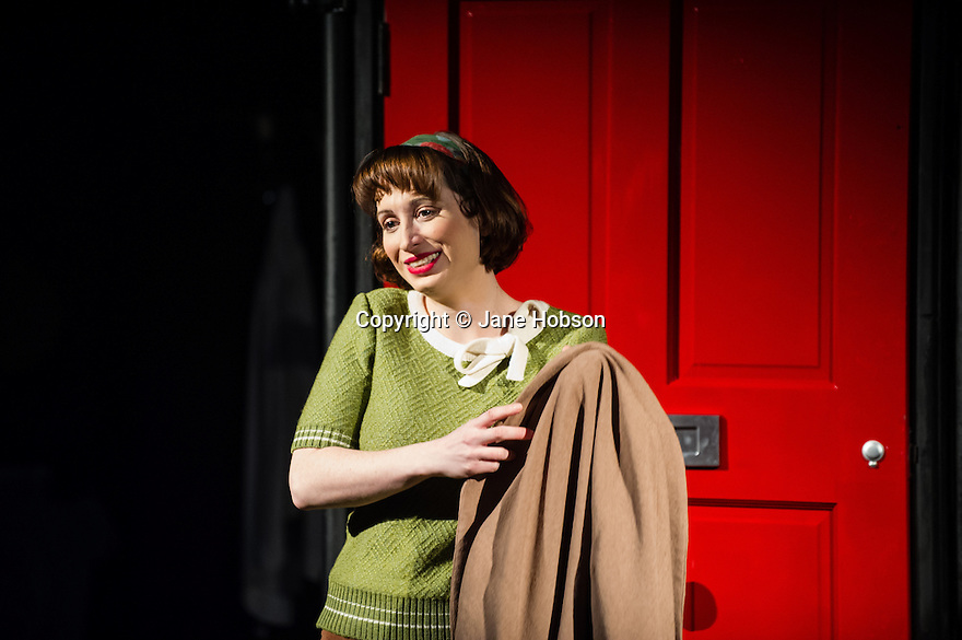 London, UK. 21.02.2014. THE A TO Z OF MRS P has its world premiere at Southwark Playhouse.  The story behind the handy, all-purpose, pocket-sized A-Z Street Guide is written by Diane Samuels (book) and Gwyneth Herbert (music and lyrics). <br />  Starring ISY SUTTIE (Peep Show / Shameless) in her first musical, as the pioneering Mrs P; with Tony Award winner FRANCES RUFFELLE (Les Miserables, Pippin, Piaf) as her emotionally fragile mother; and Olivier Award winner MICHAEL MATUS (Martin Guerre, The Baker's Wife, The Sound Of Music) as Phyllis&rsquo;s beloved and impossible father, the map publisher Sandor Gross. Directed by Sam Buntrock. Picture shows: Isy Suttie (Mrs P). <br /> Photograph &copy; Jane Hobson.