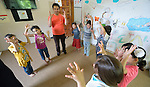 Emad Almoqari leads a group of children in an activity at the Youth Empowerment Center in Beit Hanoun, Gaza. The program is supported by Caritas and DanChurchAid, a member of the ACT Alliance, and is designed to help children better cope with the trauma they experienced during the 2014 war.<br />