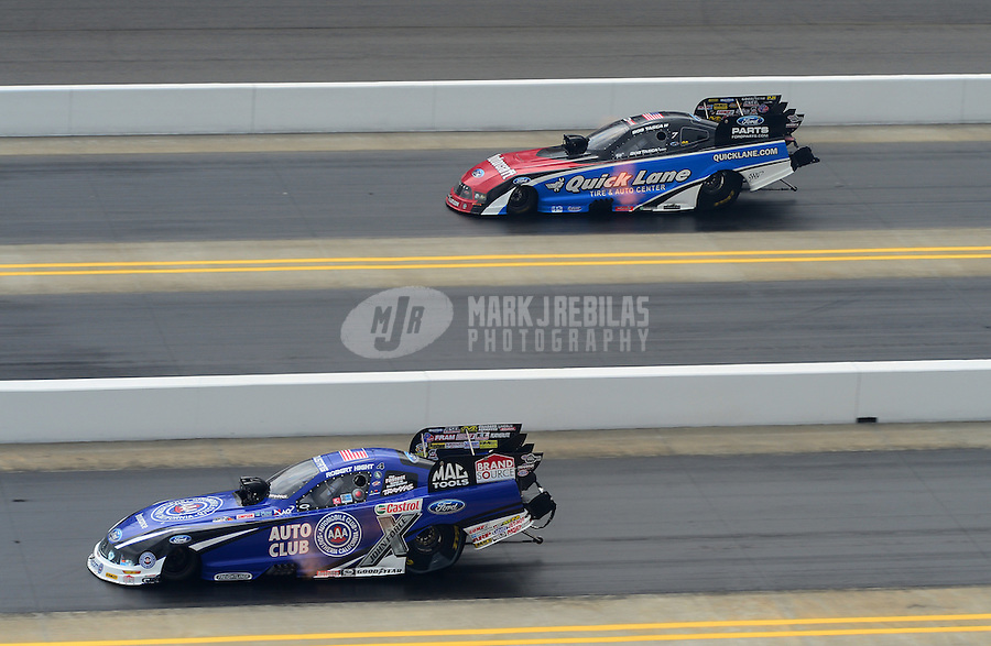 Apr. 15, 2012; Concord, NC, USA: NHRA funny car driver Robert Hight (bottom) leads Bob Tasca III during eliminations for the Four Wide Nationals at zMax Dragway. Mandatory Credit: Mark J. Rebilas-