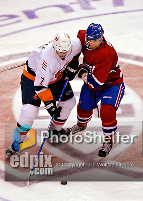 3 February 2007: Montreal Canadiens center Christopher Higgins (21) tries to take the puck away from New York Islanders right wing forward Trent Hunter (7) in the third period at the Bell Centre in Montreal, Canada. The Islanders defeated the Canadiens 4-2.Mandatory Photo Credit: Ed Wolfstein Photo *** Editorial Sales through Icon Sports Media *** www.iconsportsmedia.com