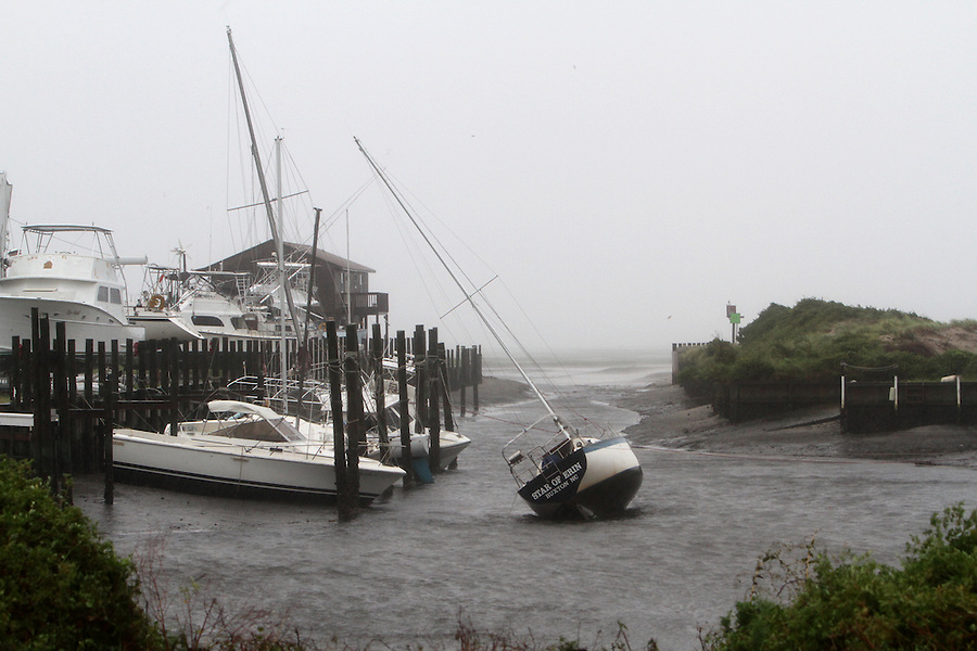 Strong easterly winds from Hurricane Irene left several boats high and dry in Pamlico Sound at Scott Boatyard in Buxton, NC, on Saturday, Aug. 27, 2011.   Residents worried about possible flooding when the winds change directions and push the Pamlico Sound waters back to the east.  Photo by Ted Richardson
