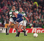 Charlie Miller eased of the ball by Celtic's John Collins and Tom Boyd in an Old Firm clash in October 1994