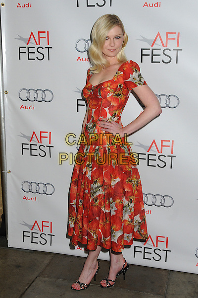 "Kirsten Dunst  .AFI Fest 2011 Special Screening of ""Melancholia"" held at the Egyptian Theater, Hollywood, California, USA..November 6th, 2011.full length dress hand on hip red white orange floral print side.CAP/ADM/BP.©Byron Purvis/AdMedia/Capital Pictures."