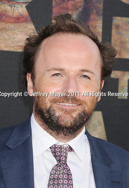 "HOLLYWOOD, CA - JULY 28: Rupert Wyatt  arrives at the ""Rise Of The Planet Of The Apes"" Los Angeles Premiere at Grauman's Chinese on July 28, 2011 in Hollywood, California."