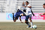 24 February 2013: Carolina's Kupono Low (left) goes flying after a challenge from Vancouver's Ethen Sampson (43). The NASL Carolina RailHawks played MLS's Vancouver Whitecaps FC at WakeMed Stadium in Cary, North Carolina in a 2013 preseason game. Vancouver won the game 3-0.