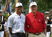 Bethesda, MD - July 4, 2007 -- Tiger Woods and former United States President George H. W. Bush stand in front of the Joint Armed Forces Color Guard during the ending ceremony preceding the inaugural Earl Woods Memorial Pro-Am Tournament, part of the AT&T National PGA Tour event, Wednesday, July 4, 2007, at the Congressional Country Club in Bethesda, Maryland. The tournament event is in honor of soldiers and military families. .Credit: Molly A. Burgess - DoD via CNP  .