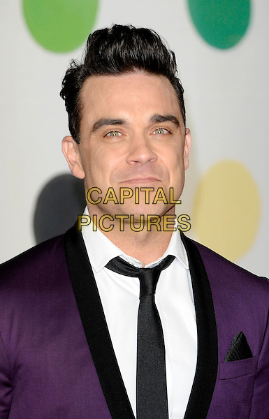Robbie Williams .The Brit Awards 2013 - Arrivals, held at The O2 Arena, London, UK, 20th February 2013..brits portrait headshot purple suit white shirt black lapel tie .CAP/DH.©David Hitchens/Capital Pictures.