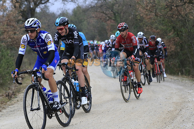 The peloton on gravel sector 2 Bagnaia during the 2017 Strade Bianche running 175km from Siena to Siena, Tuscany, Italy 4th March 2017.<br /> Picture: Eoin Clarke | Newsfile<br /> <br /> <br /> All photos usage must carry mandatory copyright credit (&copy; Newsfile | Eoin Clarke)