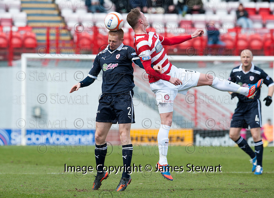Raith's Jason Thomson and Accies Jon McShane challenge for the ball.
