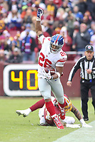 Landover, MD - December 9, 2018: New York Giants running back Saquon Barkley (26) stays in bounds during the  game between New York Giants and Washington Redskins at FedEx Field in Landover, MD.   (Photo by Elliott Brown/Media Images International)