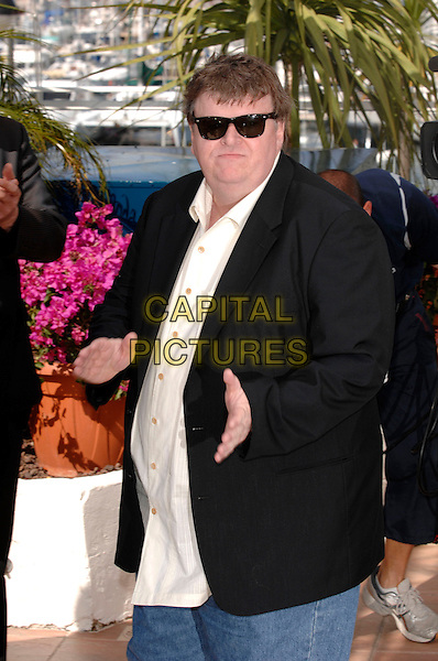 "MICHAEL MOORE.The Director attends a photocall for his film ""Sicko"" during the 60th International Cannes Film Festival,.Cannes, France, 19th May 2007..half length black jacket hands clapping sunglasses.CAP/PL.©Phil Loftus/Capital Pictures"