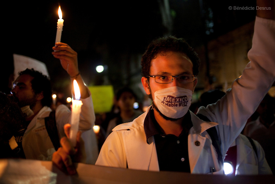 """30 June 2012 - Mexico City, Mexico - Thousands of demonstrators and university students members of the movement ?yo soy 132? (I am 132) hold candles during a demonstration to demand transparency in the next election at Zocalo square in Mexico City. """"YoSoy132"""" movement was organized by students against the candidature of Enrique Pena Nieto, presidential candidate of the opposition Institutional Revolutionary Party (PRI), who also demanded a balance in the media coverage of the presidential race. Mexico's presidential elections will take place on July 1. Photo credit: Benedicte Desrus"""