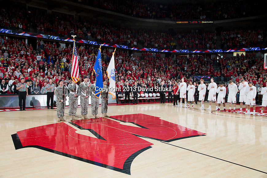 The Color Guard presents the flags during the National Anthem prior to the Wisconsin Badgers Big Ten Conference NCAA college basketball game against the Michigan Wolverines Saturday, February 9, 2013, in Madison, Wis. The Badgers won 65-62 (OT) (Photo by David Stluka)