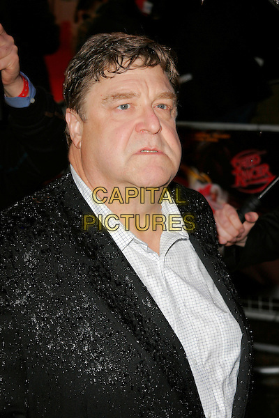 "JOHN GOODMAN.Arriving at the ""Speed Racer"" UK film premiere, Empire Leicester Square, London, England..April 28th 2008.headshot portrait wet raining .CAP/AH.©Adam Houghton/Capital Pictures."