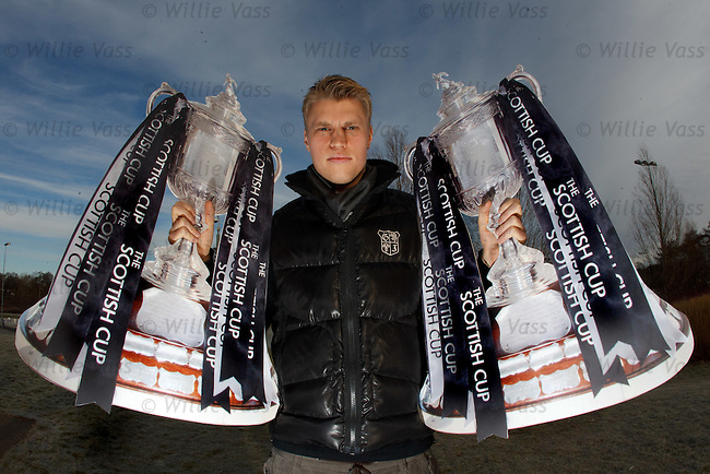 New Finnish goalkeeper Anssi Jaakkola with the Scottish Cup.**SUNDAYS**