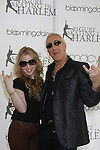 The youngest individual gold medalist in the history of the Olympic Winter Games Tara Lipinski poses with Dee Snider (Twisted Sister) and Celebrity Apprentice - The 2012 Skating - a benefit gala for Figure Skating in Harlem celebrating 15 years on April 2, 2012 at Central Park's Wollman Rink, New York City, New York.  (Photo by Sue Coflin/Max Photos)