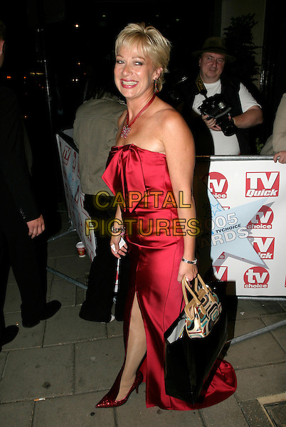 DENISE WELCH.TV Quick & TV Choice Awards at the Dorchester Hotel, Park Lane, London..September 5th, 2005.full length red silk satin dress strapless bag purse.www.capitalpictures.com.sales@capitalpictures.com.© Capital Pictures.