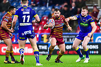 Picture by Alex Whitehead/SWpix.com - 08/02/2018 - Rugby League - Betfred Super League - Huddersfield Giants v Warrington Wolves - John Smith's Stadium, Huddersfield, England - Huddersfield's Paul Clough is tackled by Warrington's Mike Cooper.